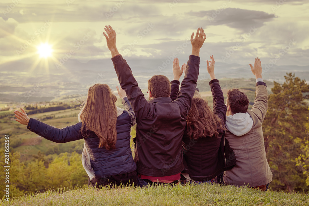 Fototapety, obrazy: Christian worship and praise. Group of friends hugging outdoors at sunset.