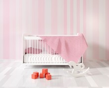 A Children's Room With A Crib ...