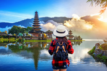 Woman Traveler With Backpack L...