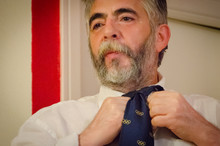 Mature Man With A Beard Puttin...