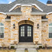 Square Home Facade With Stone Brick Wall Double Glass Paned Door And Arched Windows