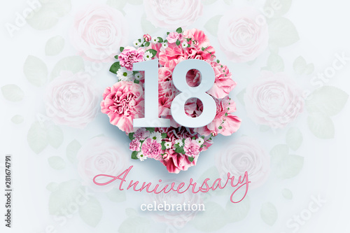 Valokuva  Creative background lettering 18 numbers and anniversary celebration text on pink flowers background