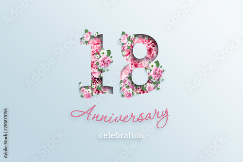 Photo  Creative background, the inscription 18 number and anniversary celebration textis flowers, on a light background
