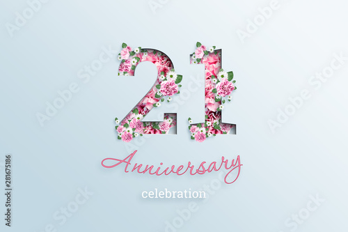 Valokuva  Creative background, the inscription 21 number and anniversary celebration textis flowers, on a light background
