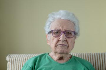 A senior woman wearing eyeglasses