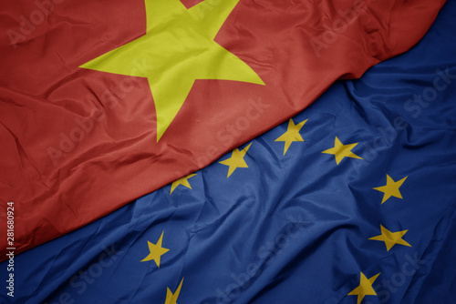 Poster Pierre, Sable waving colorful flag of european union and flag of vietnam.