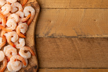 Shrimps On Wooden Background. Sea Food, Wholesome And Tasty Food. On Wooden Background. Background For Cooking, Menu, Selling Seafood, With Space