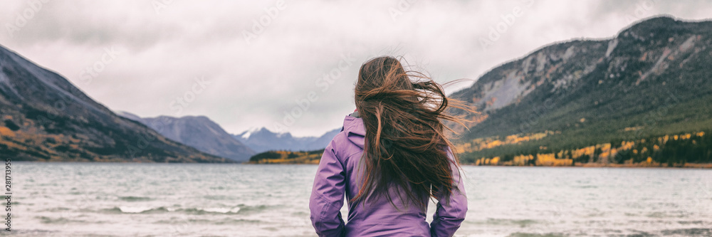 Fototapeta Nature travel panoramic banner woman hiker adventure wanderlust in Yukon travel tourist walking on beach in Carcross, Canada.