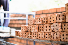 Pile Of Of  Bricks Placing In Row Prepared For New House Construction