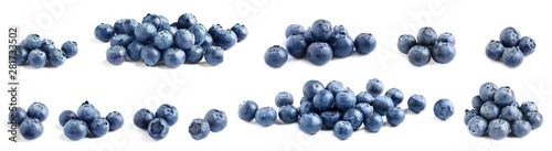 Vászonkép Set of delicious fresh blueberries on white background