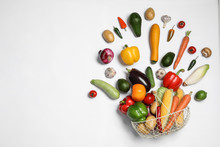 Fresh Vegetables And Metal Basket On White Background, Top View