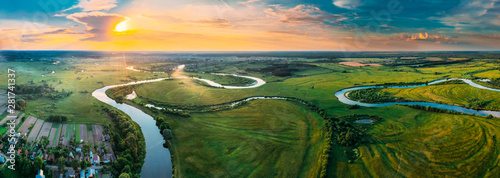 Canvas Print Aerial View Green Forest Woods Meadow And River Landscape In Sunny Spring Evening