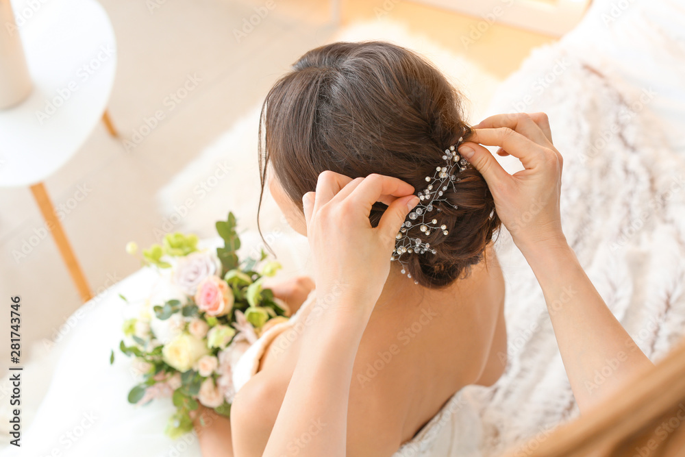 Fototapeta Professional hairdresser working with young bride at home