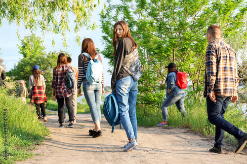 Valokuvatapetti Group of illegal migrants escaping from their country
