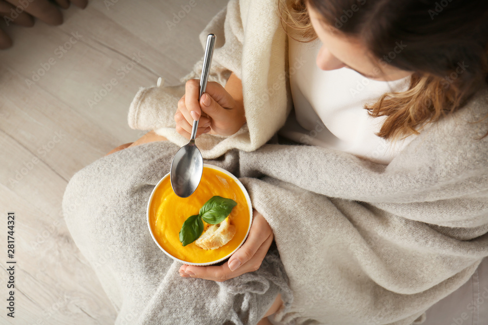 Fototapety, obrazy: Woman eating tasty cream soup at home