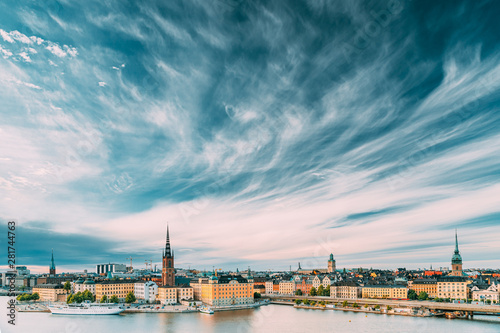Photo sur Aluminium Stockholm Stockholm, Sweden. Scenic Famous View Of Embankment In Old Town Of Stockholm At Summer. Gamla Stan In Summer Evening. Famous Popular Destination Scenic Place And UNESCO World Heritage Site