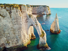 Picturesque Landscape Of White Chalk Cliffs And Natural Arches Of Etretat, France