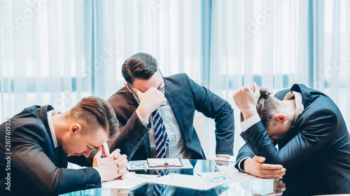Obraz Business failure and bankruptcy. Stressed out company executive managers sitting in boarding room, thinking. - fototapety do salonu