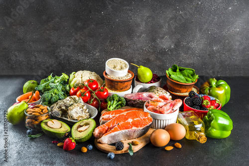 Pescetarian diet plan ingredients, healthy balanced grocery food, fresh fruit, berries, fish and shellfish clams,  black background copy space  - 281762722