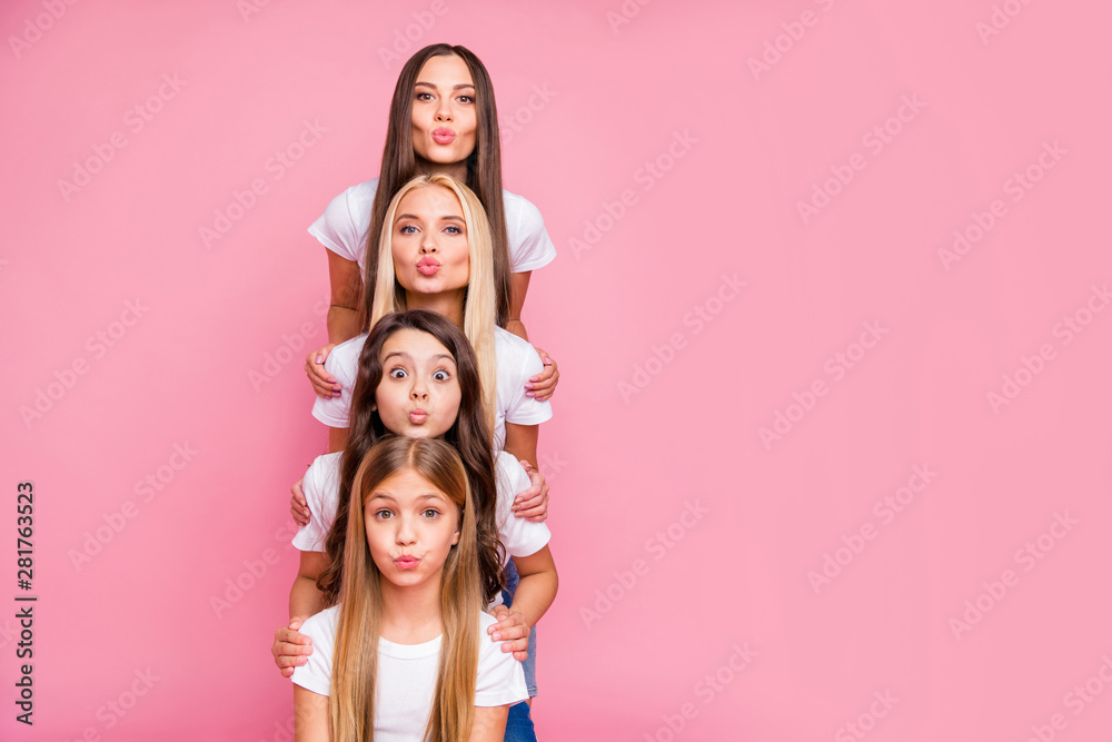 Fototapety, obrazy: Nice attractive lovely lovable winsome cheerful cheery funny long haired girls relatives building vertical top pyramid sending air kiss embracing isolated over pink pastel background