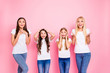 Photo of four different age ladies listening positive news wear casual outfit isolated pink background