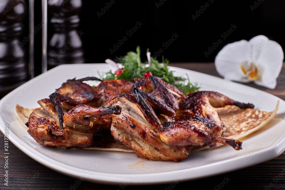 Fototapety, obrazy: Fried quail on a plate on a wooden board
