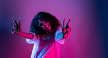 Fashion Young African Girl Black Woman Wear Stylish Pink Glasses Dance Look At Camera Show Peace Gesture Enjoying Festive Party Isolated On Disco Purple Studio Background, Portrait, Copy Space