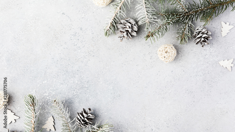 Fototapeta Christmas composition. Christmas fir tree branches, gifts, pine cones on wooden white rustic background. Flat lay, top view. Copy space. Banner backdrop