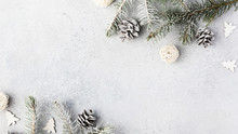 Christmas Composition. Christmas Fir Tree Branches, Gifts, Pine Cones On Wooden White Rustic Background. Flat Lay, Top View. Copy Space. Banner Backdrop