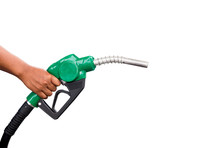 Hand Holding Gas Nozzle With One Last Drop. A Man Holding A Green Gasoline Nozzle On A White Background. Hands Of Men Who Were Holding An Automatic Nozzle To Make Refill Oil.