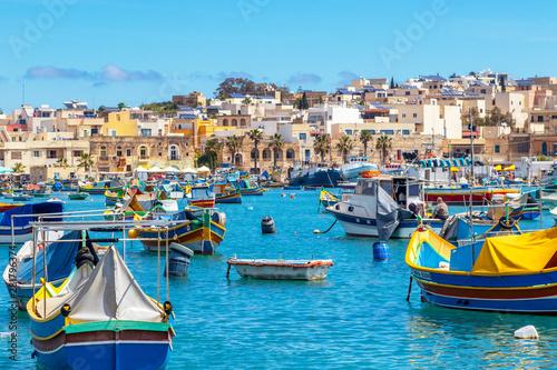 Photo sur Aluminium Piscine The traditional eyed boats in the harbor of fishing village Marsaxlokk in Malta