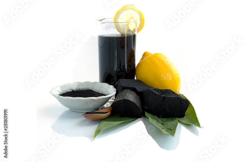 Canvas Print Detox activated charcoal black lemonade on white background, with leaves and lem