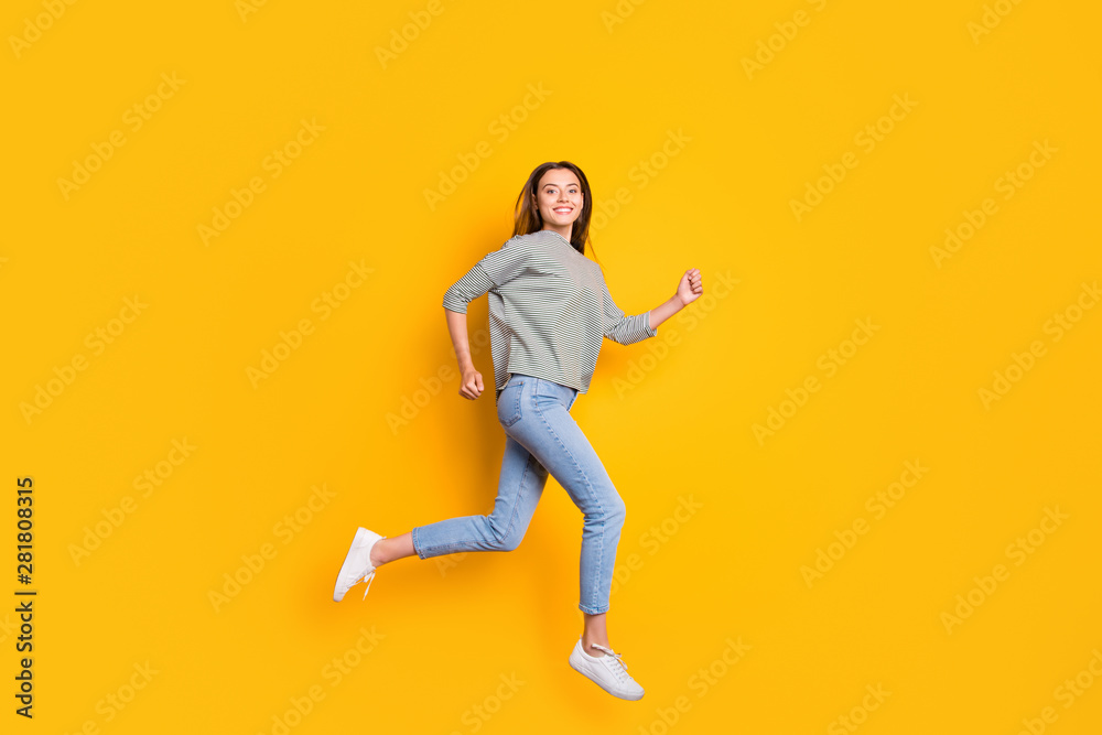 Fototapeta Full length body size photo of excited cheerful girlfriend running towards her dreams while isolated with yellow background