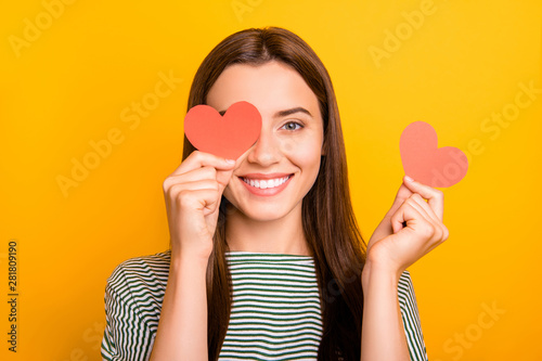 Fotografie, Tablou  Photo of cute playful girl looking out of one hearts given her as present for va