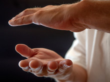 Human Hand Training In Karate, Tai-chi, Martial Arts. White Shirt On Black Background.