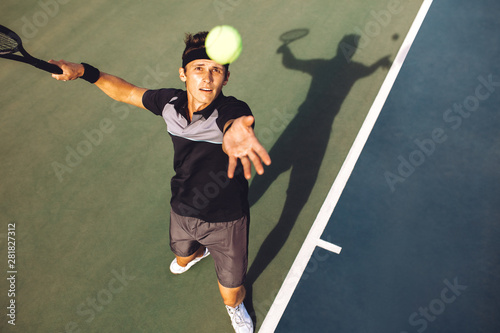 Fototapeta Tennis player Tossing the ball for the serve