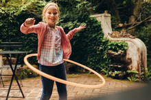Girl Playing With A Hoopla Ring