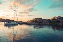 Sailing Boat On The Island Over Sunset Colourful Sky With Reflection In The Water In The Island Summertime, Sweden