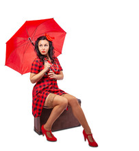 Young Woman With Umbrella Pinup Style Sitting In A Suitcase
