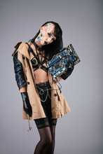 Young Cyborg Woman Holding A Motherboard