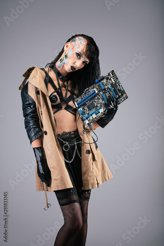 Young cyborg woman holding a motherboard Wallpaper Mural