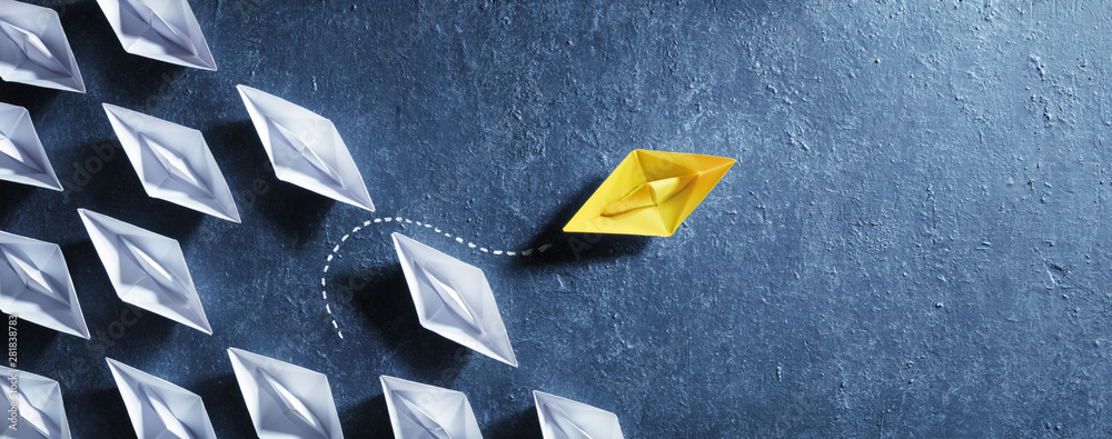 Fototapeta Opportunities Business Concept - Paper Boat Change Direction