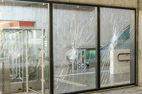 Protests terrorists terrorist attack broken window glass subway showcase rebelli Fototapeta