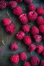 Fresh Raspberries On A Rustic Metal Surface