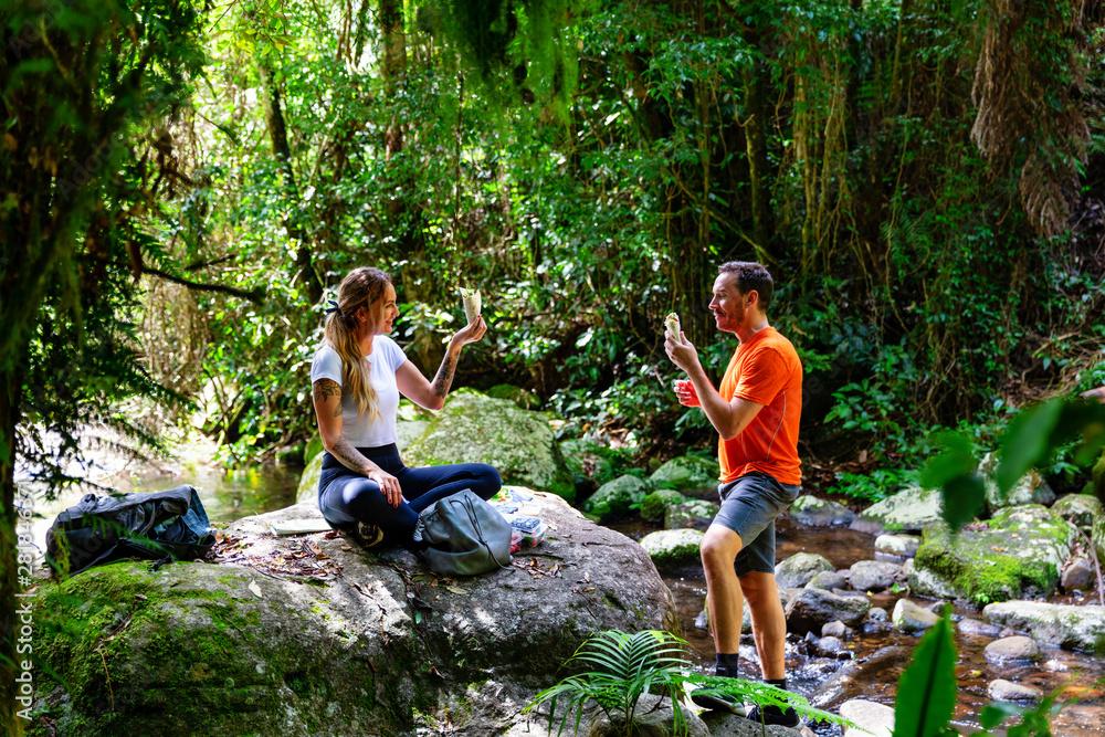 Fototapety, obrazy: Couple enjoying lunch in lush Australian rainforest