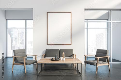 Fotografía  Spacious white living room interior with poster