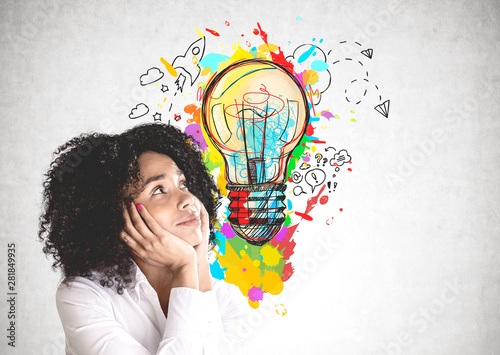 Thoughtful young woman and her bright idea
