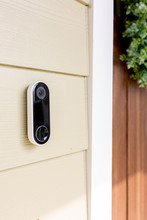 Modern Doorbell On Front Of Home