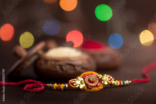 Indian festival: Raksha Bandhan background with an elegant Rakhi, Rice Grains and Kumkum Canvas Print