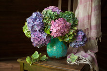 Bouquet Of Hydrangea Flowers In A Vase On A Chair